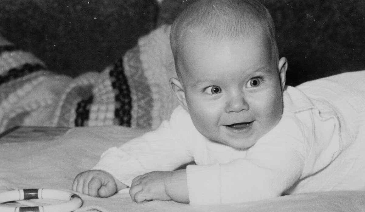 Claudia as a baby with a visible convergent squint in her right eye.